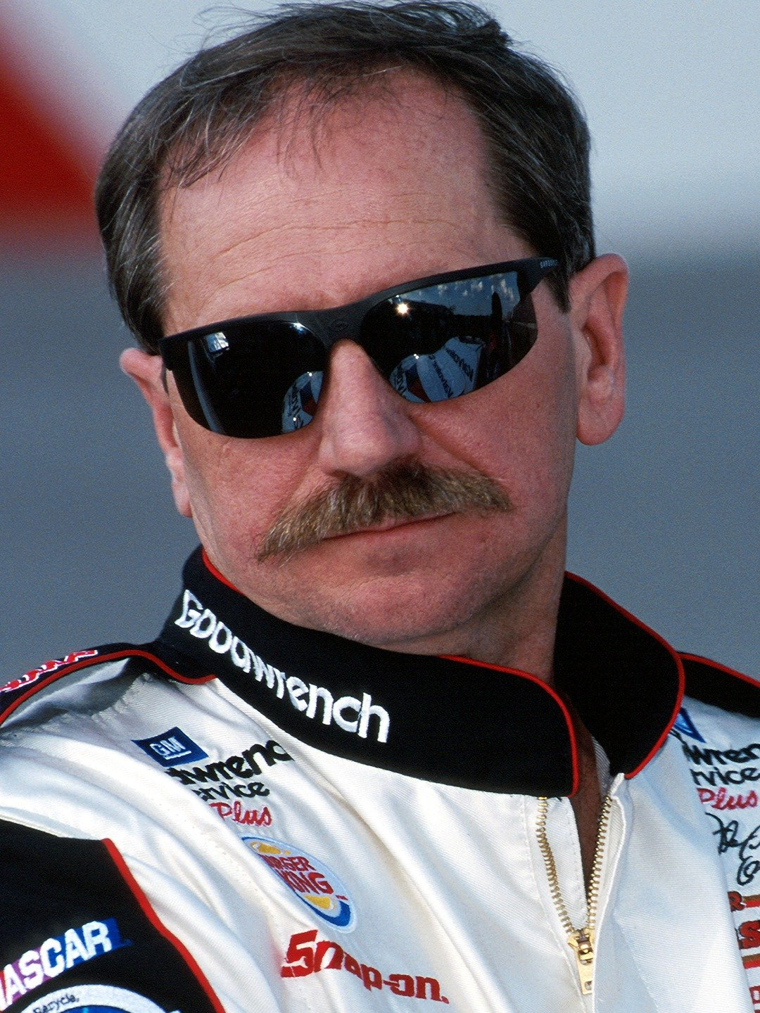 Dale Earnhardt holds his classic pose wearing his trademark sunglasses at Rockingham Internationa Speedway, February of 2000. (Newscom TagID: iconphotos258988.jpg) [Photo via Newscom]